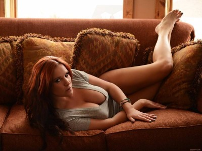 Hot and naughty redhead on hte couch
