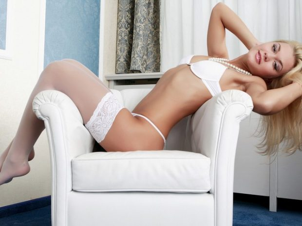 Sensual massage girl in white lingerie
