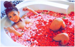 Romantic woman in bathtub with roses