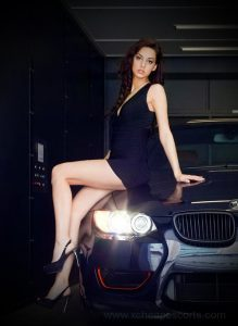 Sexy woman on a car