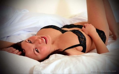 Kinky woman in bed
